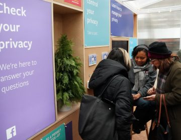 Facebook employees talk to visitors at a one-day Facebook pop-up kiosk in Bryant Park in New York City on Thursday. The company was fielding questions about its data-sharing practices and teaching users how to understand its new privacy controls. The next day, Facebook announced that a