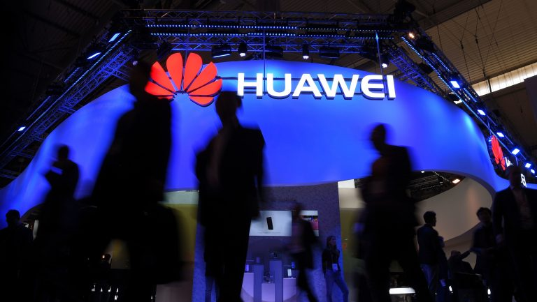 Visitors pass a Huawei marquee in Barcelona during the Mobile World Congress last year. The daughter of the Chinese telecommunications giant's founder was arrested Saturday in Canada on U.S. request, in a move that threatens to inflame U.S.-China trade tensions. (Lluis Gene/AFP/Getty Images)