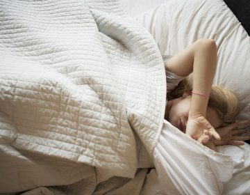 Teens' biological clock drives them to stay up late and sleep in. Most school start times don't accommodate that drive. (Jasper Cole/Getty Images)