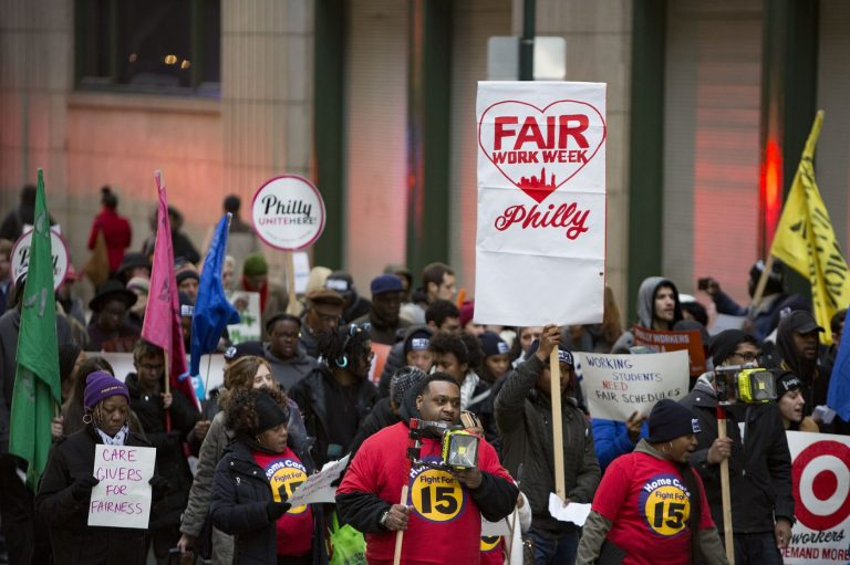 Fast food and retail workers and their supporters marched through Center City to kick off the fight for
