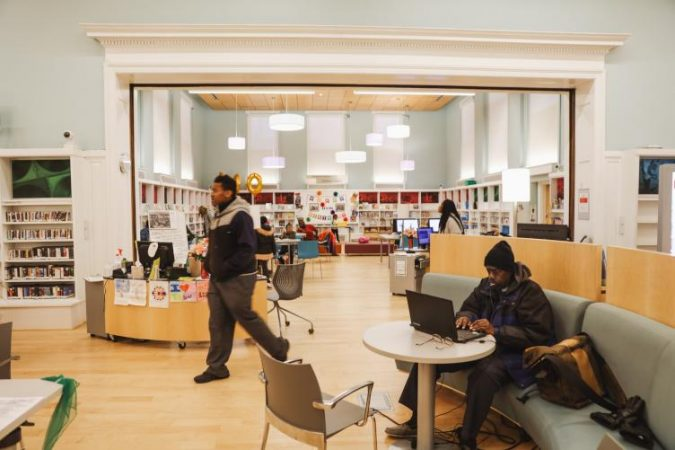 Logan Library buzzes with young people after school (Neal Santos for PlanPhilly)