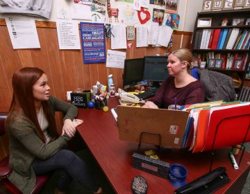 Kim Cooney, director of student success at Chestnut Hill College, meets with senior Erin Crowley. After changing her major, she took extra classes so she could graduate on time. Chestnut Hill started a program this year to get more students to choose a major by sophomore year. (Saquan Stimpson for The Hechinger Report)