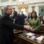 Philadelphia Mayor Jim Kenney, left, shakes hands with members of City Council after speaking at City Hall in Philadelphia, Thursday, Nov. 2, 2017. Kenney on Thursday called for the panel that governs the city's schools to be dissolved and replaced by mayor-appointed board. (AP Photo/Matt Rourke)