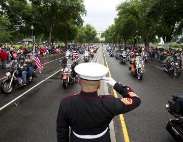 A U.S. Marine salutes as participants in the Rolling Thunder motorcycle rally rumble through Washington, D.C., in 2017. Organizers say the 2019 event will be the last in D.C. (AFP/Getty Images)