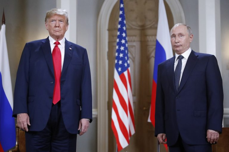 U.S. President Donald Trump, left, and Russian President Vladimir Putin pose for a photograph at the beginning of a one-on-one meeting at the Presidential Palace in Helsinki, Finland, Monday, July 16, 2018. (Pablo Martinez Monsivais/AP Photo)