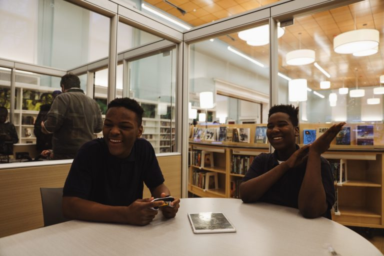 Shyeer Johnson and Waki Perry, both 14, frequent the library after school. (Neal Santos for PlanPhilly)
