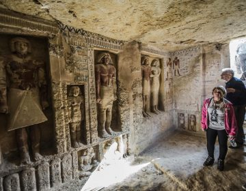 Visitors enter a newly-discovered Egyptian tomb at the Saqqara necropolis on Saturday. (Khaled Desouki/AFP/Getty Images)