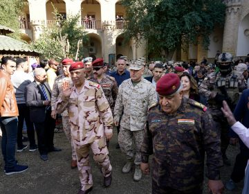 U.S. Marine Brig. Gen. Austin Renforth (center) went with his Iraqi counterpart, Lt. Gen. Jalil Jabbar al-Rubaie (center left), for a tour of Baghdad's most crowded neighborhoods on Friday. (Mootaz Sami/AP Images for NPR)