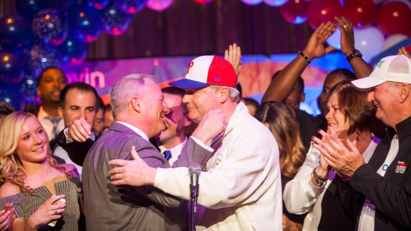 Pennsylvania Supreme Court Judge Elect Kevin Dougherty (left) hugs his brother John Dougherty at a post-election party at the Stagehands Union Hall in South Philadelphia. (Brad Larrison for WHYY)