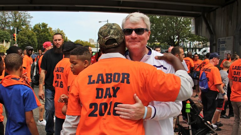 Labor leader John Dougherty embraces a union member during the Labor Day parade in Philadelphia on Sept. 5, 2016. (Emma Lee/WHYY)