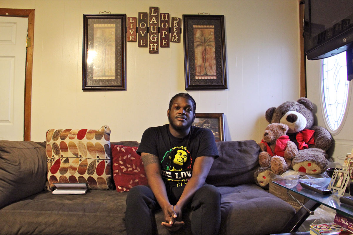 Clive Thompson Jr., 21, of Cedarville, N.J., planned to continue college this year. But since his parents, natives of Jamaica, got a deportation order, he's been busy looking after their house and helping to pay their mortgage while they take sanctuary in a Philadelphia church. (Emma Lee/WHYY)