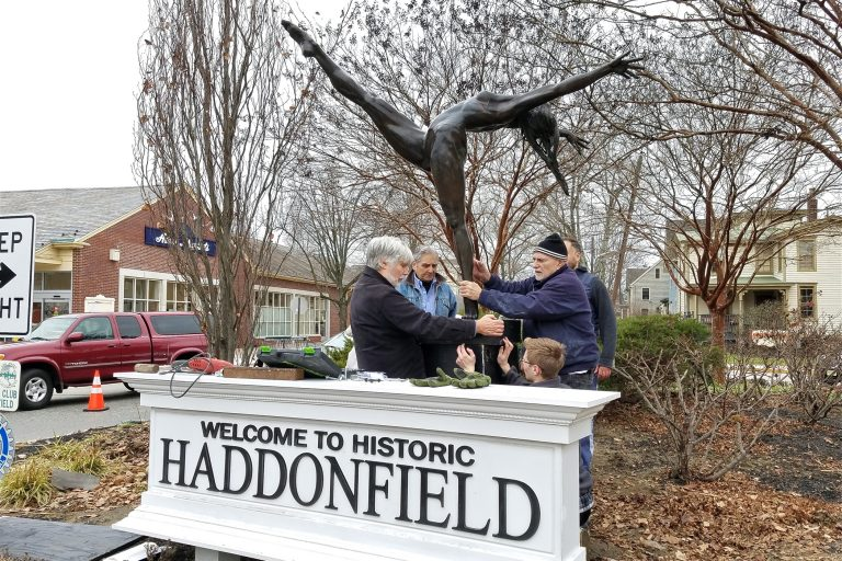Members of the Haddonfield Outdoor Sculpture Trust install