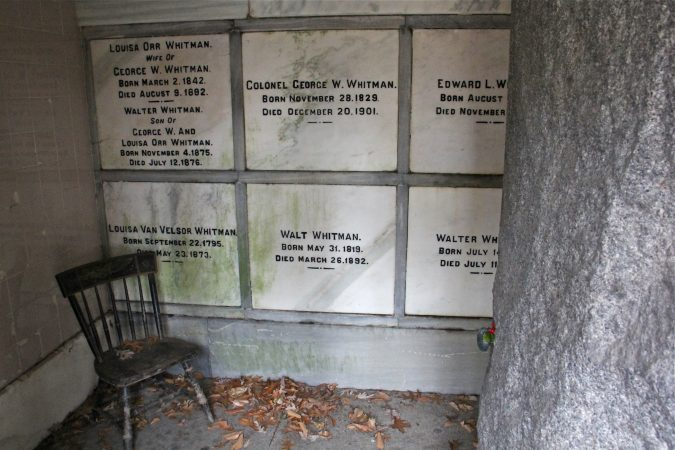 Walt Whitman is buried in a granite crypt set into a hillside in Harleigh Cemetery in Camden, along with several family members. (Emma Lee/WHYY)
