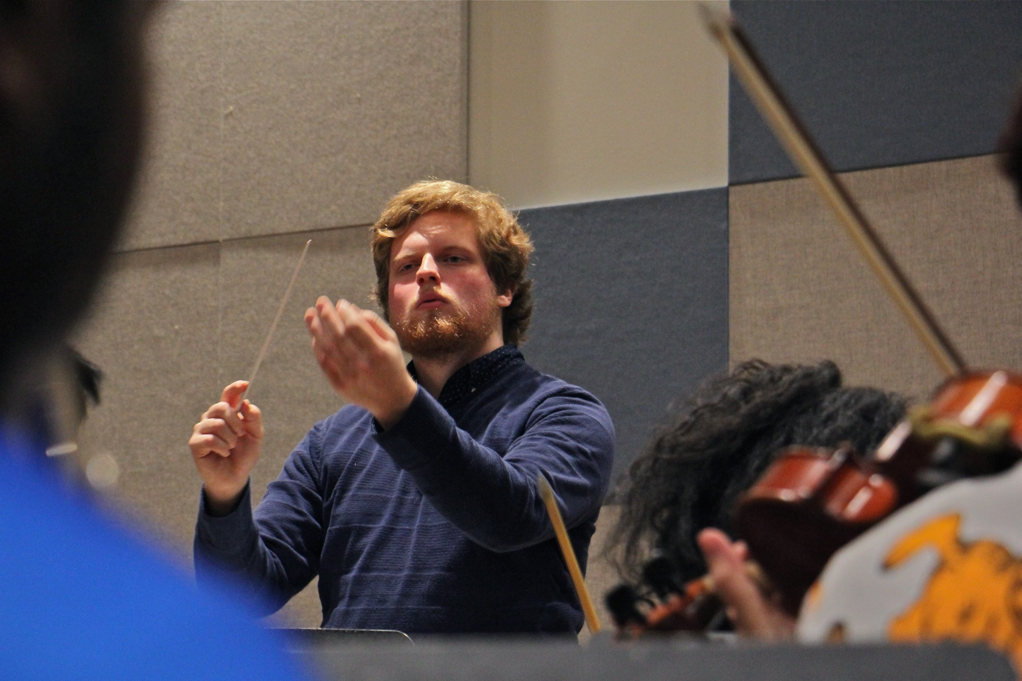 Davey Hiester conducts the student-led Center City Chamber Orchestra during rehearsal at Settlement Music School.