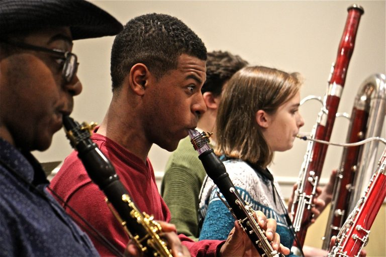 Marquise Bradley, a founding member of the Center City Chamber Orchestra, plays during rehearsal at Settlement Music School. (Emma Lee/WHYY)