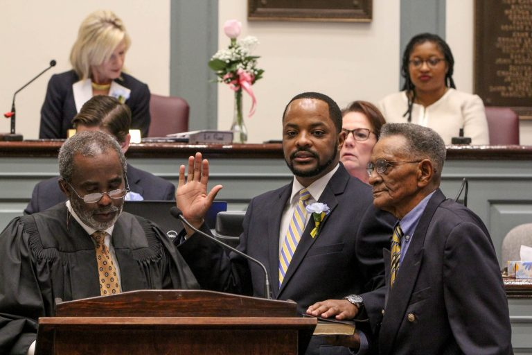 Darius Brown is sworn in as a Delaware state senator at Legislative Hall in Dover. He is one of 15 new faces in the Delaware General Assembly. (Emma Lee/WHYY)