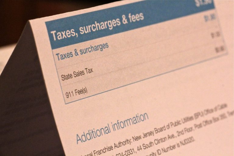 A New Jersey phone bill shows a 90 cent 911 fee. (Emma Lee/WHYY
