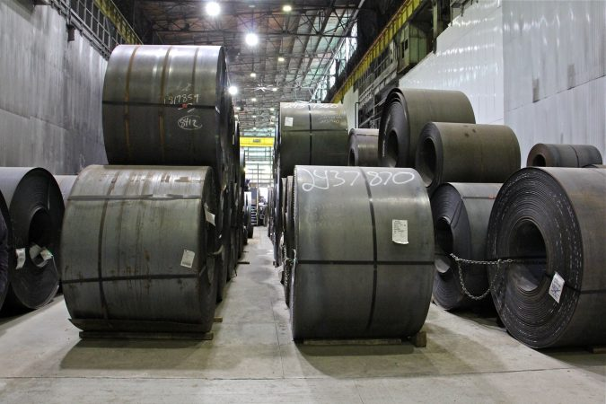Steel rolls await processing in a warehouse at Camden Yards Steel Company in Camden. (Emma Lee/WHYY)