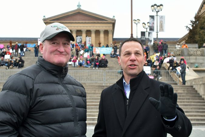 Philadelphia Mayor Jim Kenney and Pennsylvania Attorney General Josh Shapiro look over the crowed gathered in front of the stage at the Art Museum steps during the 2019 Women's March. (Bastiaan Slabbers for WHYY)