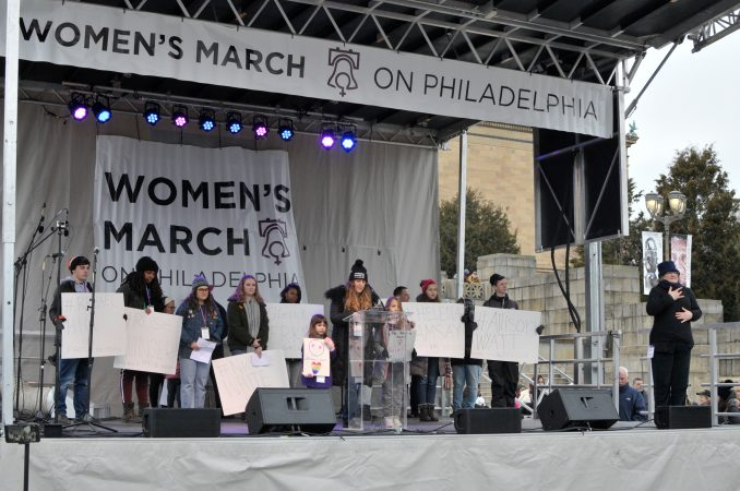 Amy Martin, one of the event's organizer, shares her #MeToo experiences on stage at the Art Museum steps, during the Women's March, January 19, 2019. (Bastiaan Slabbers for WHYY)