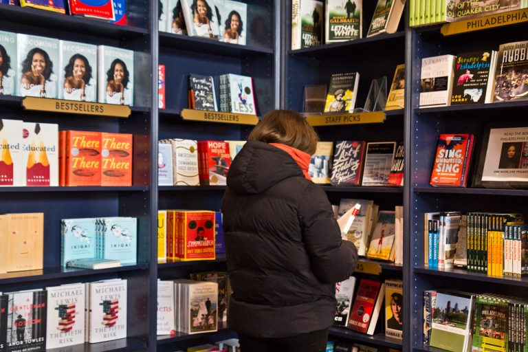 A customer browses the shelves at Shakespeare & Co. in Center City. (Kimberly Paynter/WHYY)