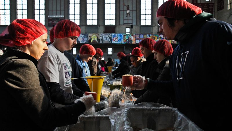 Rise Against Hunger packages dried meals at the MLK Day of Service at Girard College. (Kimberly Paynter/WHYY)