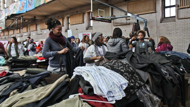 Volunteers organize professional clothing for at the MLK Day of Service at Girard College. (Kimberly Paynter/WHYY)