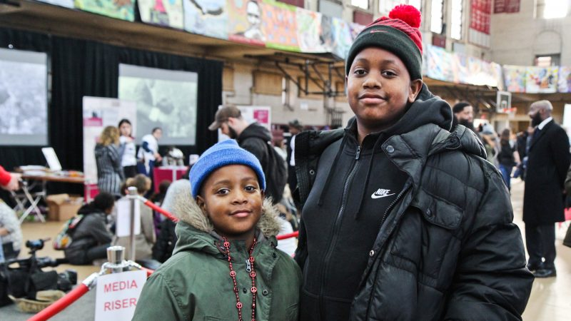 Justin Shuford , 8, (left) and his brother Darrion, 14, (right) participate in the MLK Day of Service at Girard College. (Kimberly Paynter/WHYY)