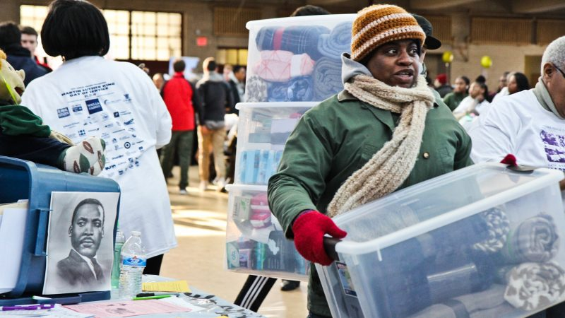 Participants collect blankets  at the MLK Day of Service at Girard College. (Kimberly Paynter/WHYY)