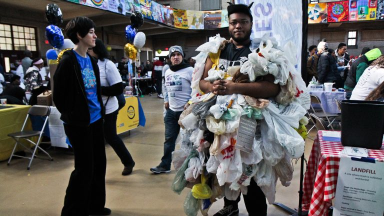 Timell Sherard dress as the plastic bad monster to convince people to cut back on plastic bag use. (Kimberly Paynter/WHYY)