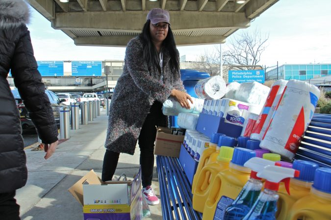 Alora Miller unloads donated supplies at Philadelphia International Airport for TSA employees who continue to work during the government shutdown but are not getting paid. (Emma Lee/WHYY)
