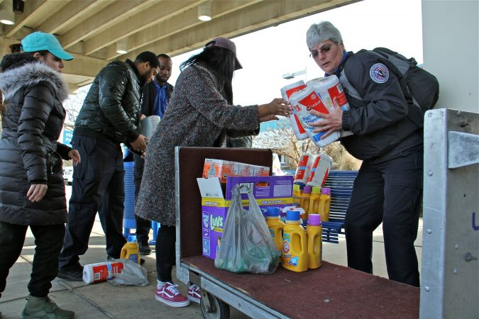 TSA employees collect donated supplies from Alora Miller at Philadelphia International Airport. (Emma Lee/WHYY