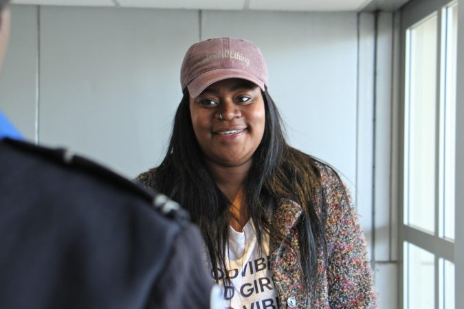 Alora Miller talks with TSA employee Lashanda Palmer after delivering a load of supplies for federal workers who have to work during the government shutdown, but aren't being paid. (Emma Lee/WHYY)