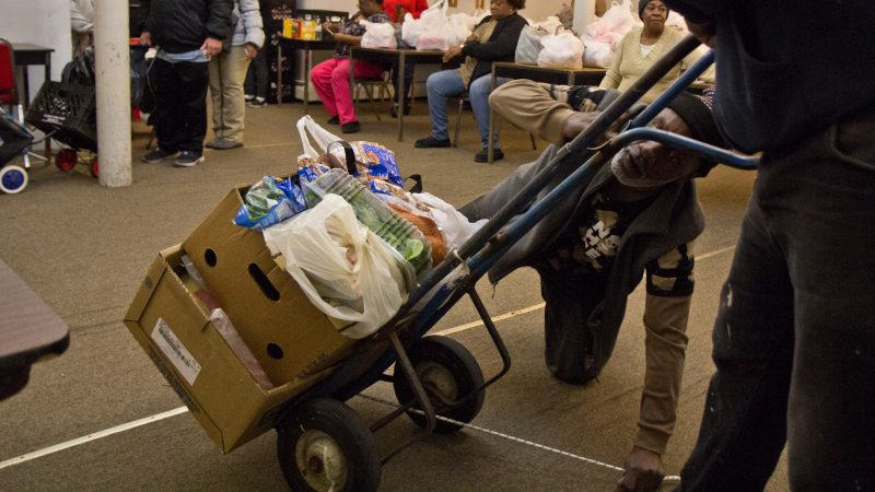 Volunteers in Reading hand out food and help the older and disabled. (Kimberly Paynter/WHYY)
