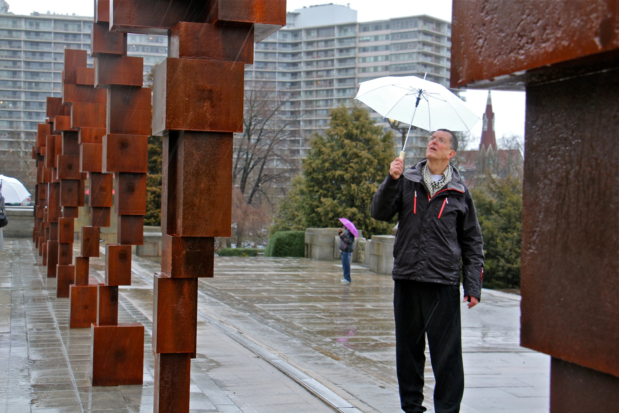 "Anthony Gormley walks among his ""Blockworks"" sculptures on the upper terrace of the Philadelphia Museum of Art."