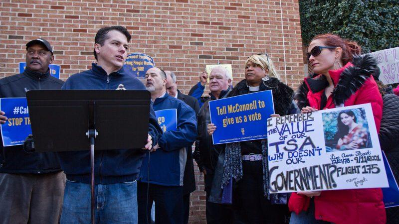 U.S. Congressman Brendan Boyle calls for an end to government shutdown outside Philadelphia International airport Friday. (Kimberly Paynter/WHYY)