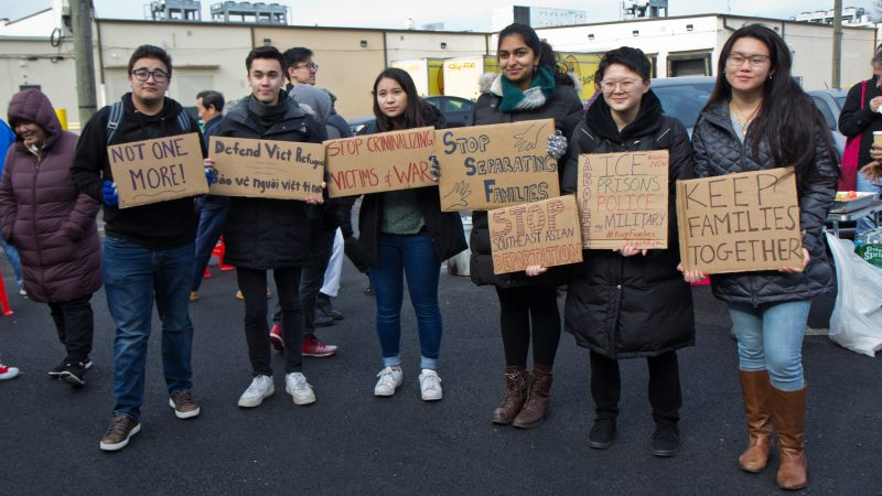 Members and supporters of Philadelphia's Southeastern Asian community protest deportations at a shopping center on West Oregon Avenue on Sunday, Jan. 27, 2019. (Kimberly Paynter/WHYY)