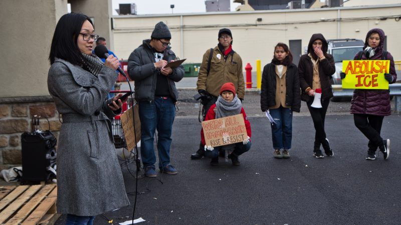 Spoken word poet Dianne Le performs at a protest to end deportations at a shopping center on West Oregon Avenue in Philadelphia on Sunday, Jan. 27, 2019. (Kimberly Paynter/WHYY)