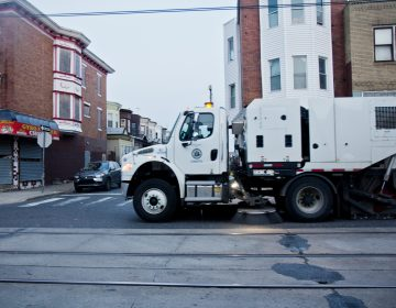 A city street sweeper cleans Chester Avenue in Southwest Philadelphia. (Kimberly Paynter)