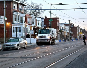 A city street sweeper cleans Chester Avenue in Southwest Philadelphia on Jan. 3, 2019. (Kimberly Paynter/WHYY)