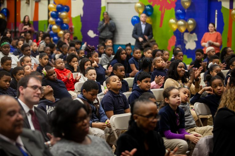 John F. Hartranft Elementary students listen to speakers at a ceremony honoring the announcement of this year's school progress reports. (Brad Larrison for WHYY)