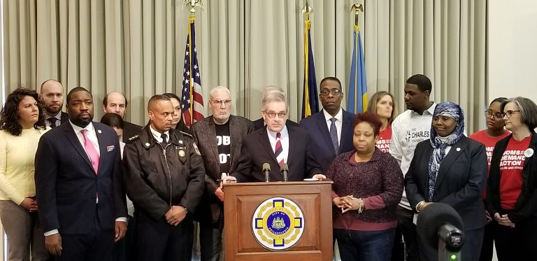 Philadelphia District Attorney Larry Krasner announces his intention to enforce a 2009 city law that mandates gun owners report a weapon's loss or theft to police. The National Rifle Association is taking issue with that move. (Tom MacDonald/ WHYY)
