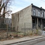 A Philadelphia judge purchased this row home at 1514 N. Hollywood Street and the two adjacent vacant lots. (Emma Lee/WHYY)