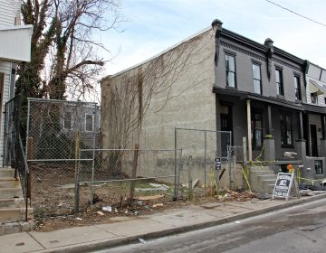 A Philadelphia judge purchased this row home at 1514 N. Hollywood Street and the two adjacent vacant lots from the city. (Emma Lee/WHYY)