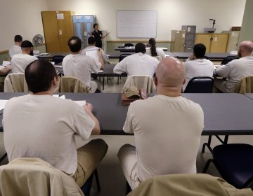 In this photo taken Thursday, Jan. 28, 2016, inmates look on in their college world history class at the Monroe Correctional Complex in Monroe, Wash. College education in American prisons is starting to grow again, more than two decades since federal government dollars were prohibited from being used for college programs behind bars. (Elaine Thompson/AP Photo)