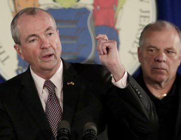 In this June 30, 2018, file photo, New Jersey Gov. Phil Murphy, (left), discusses his state budget deal with Democratic legislative leaders, as state Senate President Stephen Sweeney, (right), listens during a news conference in Trenton, N.J. (Julio Cortez/AP Photo, File)