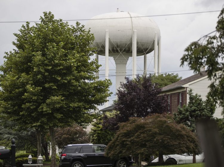In this Aug. 1, 2018 photo, a water tower stands above a residential neighborhood in Horsham, Pa. In Horsham and surrounding towns in eastern Pennsylvania, and at other sites around the United States, the foams once used routinely in firefighting training at military bases contained per-and polyfluoroalkyl substances, or PFAS.  (Matt Rourke/AP Photo)