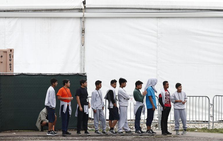 Migrant teens walk in a line at a shelter for unaccompanied children, on Monday, Dec. 10, 2018. (Brynn Anderson/AP Photo)