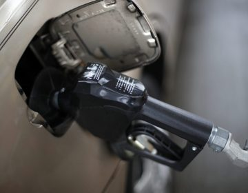 In this Nov. 16, 2018, file photo, a gas pump nozzle fills up gas in a car at a pump in West Mifflin, Pa. (Gene J. Puska /The Associated Press)