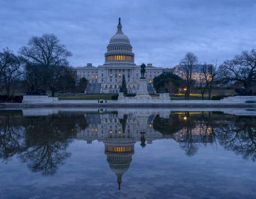 The Capitol is seen under early morning skies in Washington, Thursday, Dec. 20, 2018. A partial federal shutdown has dragged on for more than two weeks. Many federal employees missed their first paycheck on Friday. (AP Photo/J. Scott Applewhite)